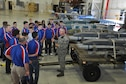 Chief Master Sgt. Tod Bell, 301st Aircraft Maintenance Squadron's superintendent, provides an overview of the munitions used on an F-16 Fighting Falcon to Junior Reserve Officer Training cadets during a tour around Naval Air Station Fort Worth Joint Reserve Base, Texas, Oct. 5, 2016. Forty-two cadets from Burleson high school explored the 301st Civil Engineer Squadron Explosive Ordnance Disposal demonstration, the Army Bravo Company 90th Aviation Support Battalion's Black Hawk helicopter, the base control tower and its radar site. (U.S. Air Force photo by Julie Briden-Garcia)