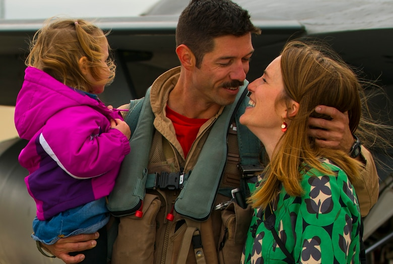 An Airman from the 480th Expeditionary Fighter Squadron embraces his wife during a homecoming event on the flightline at Spangdahlem Air Base, Germany, Oct. 6, 2016. The 480th EFS returned safely to home station after a six-month deployment to Southwest Asia. (U.S. Air Force photo by Senior Airman Dawn M. Weber)