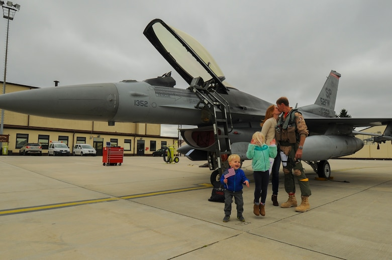 An Airman assigned to the 480th Expeditionary Fighter Squadron reunites with his family during the squadron's return to Spangdahlem Air Base, Germany, Oct. 6, 2016. Approximately 300 of the Airmen, who serve in flight, maintenance or support roles for the F-16 Fighting Falcon fighter aircraft, completed a six-month deployment to Southwest Asia by providing close air support and dynamic targeting operations as part of the squadron's first deployment in support of Operation Inherent Resolve. Operation Inherent Resolve aims to eliminate the Da'esh terrorist group and the threat they pose to Iraq, Syria and the wider international community. (U.S. Air Force photo by Staff Sgt. Joe W. McFadden)