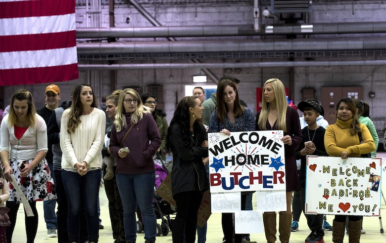 Friends and family members of Airmen assigned to the 480th Expeditionary Fighter Squadron await the squadron's arrival back to Spangdahlem Air Base, Germany, Oct. 12, 2016. Approximately 300 squadron members arrived from a six-month deployment to Southwest Asia where they provided close air support and dynamic targeting operations in support of Operation Inherent Resolve. (U.S. Air Force photo/Airman 1st Class Preston Cherry)