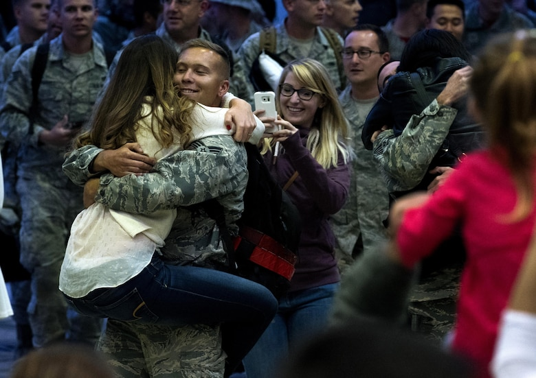 Airmen assigned to the 480th Expeditionary Fighter Squadron reunite with friends and family during the squadron's return to Spangdahlem Air Base, Germany, Oct. 12, 2016. Approximately 300 squadron members arrived from a six-month deployment in Southwest Asia where they provided close air support and dynamic targeting operations in support of Operation Inherent Resolve. (U.S. Air Force photo/Airman 1st Class Preston Cherry)