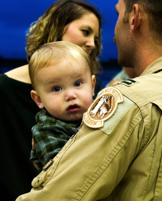 An Airman from the 480th Expeditionary Fighter Squadron holds his son after returning to Spangdahlem Air Base, Germany, Oct. 12, 2016. The squadron completed a six-month deployment to Southwest Asia to support Operation Inherent Resolve, which aims to defeat enemy forces in the Combined Joint Force Area. (U.S. Air Force photo/Airman 1st Class Preston Cherry)