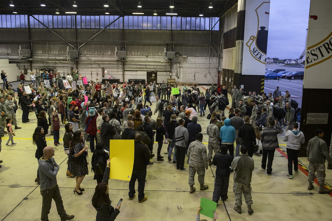 Hundreds of families reunite with their returning Airmen assigned to the 480th Expeditionary Fighter Squadron during the squadron's return to Spangdahlem Air Base, Germany, Oct. 12, 2016. Approximately 300 of the squadron's Airmen, who serve in flight, maintenance or support roles for the F-16 Fighting Falcon fighter aircraft, completed a six-month deployment to Southwest Asia by providing close air support and dynamic targeting operations in support of Operation Inherent Resolve. (U.S. Air Force photo by Staff Sgt. Jonathan Snyder)