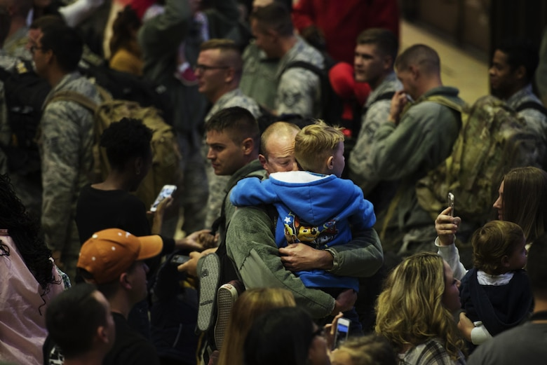 An Airman reunites with his son during the 480th Expeditionary Fighter Squadron return from Southwest Asia to Spangdahlem Air Base, Germany, Oct. 12, 2016. The 480th EFS deployed in support of Operation Inherent Resolve's, which aims to militarily defeat enemy forces in the Combined Joint Operations Area by, with and through regional partners in order to enable whole-of-governmental actions to increase regional stability by conducting a campaign against enemy forces in Iraq and Syria. (U.S. Air Force photo by Staff Sgt. Jonathan Snyder)