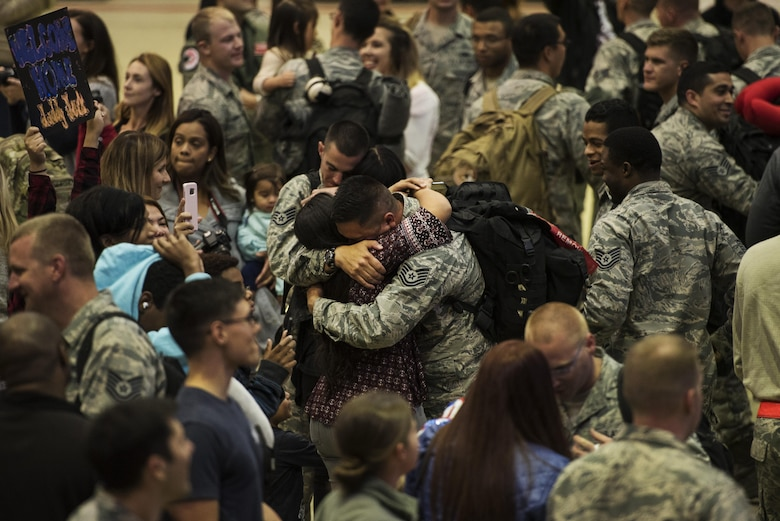 Airmen assigned to the 480th Expeditionary Fighter Squadron reunite with their loved ones during the squadron's return to Spangdahlem Air Base, Germany, Oct. 12, 2016. Approximately 300 of the squadron's Airmen, who serve in flight, maintenance or support roles for the F-16 Fighting Falcon fighter aircraft, completed a six-month deployment to Southwest Asia by providing close air support and dynamic targeting operations in support of Operation Inherent Resolve. (U.S. Air Force photo by Staff Sgt. Jonathan Snyder)