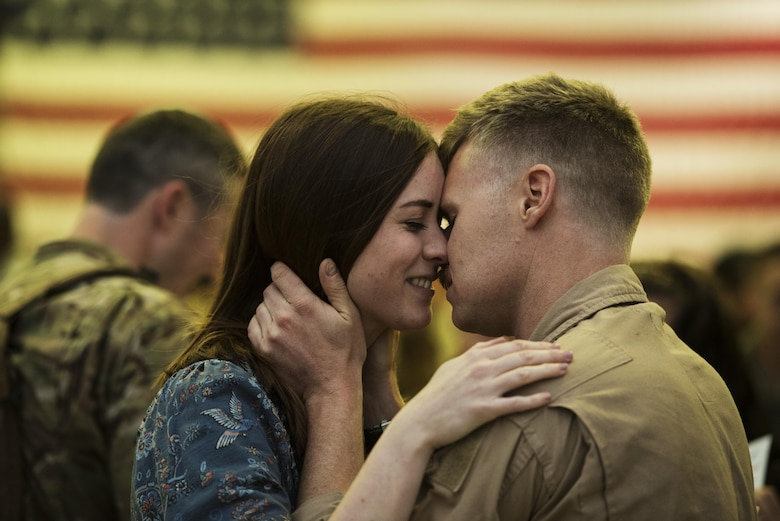 An Airman assigned to the 480th Expeditionary Fighter Squadron reunites with his loved one during the squadron's return from Southwest Asia to Spangdahlem Air Base, Germany, Oct. 12, 2016. The 480th EFS deployed in support of Operation Inherent Resolve's, which aims to militarily defeat enemy forces in the Combined Joint Operations Area by, with and through regional partners in order to enable whole-of-governmental actions to increase regional stability by conducting a campaign against enemy forces in Iraq and Syria. (U.S. Air Force photo by Staff Sgt. Jonathan Snyder)