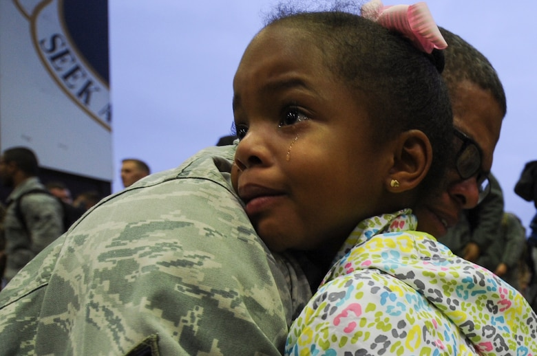 An Airman assigned to the 480th Expeditionary Fighter Squadron holds his daughter during the squadron's return to Spangdahlem Air Base, Germany, Oct. 12, 2016. Approximately 300 of the Airmen, who serve in flight, maintenance or support roles for the F-16 Fighting Falcon fighter aircraft, completed a six-month deployment to Southwest Asia by providing close air support and dynamic targeting operations as part of the squadron's first deployment in support of Operation Inherent Resolve. Operation Inherent Resolve aims to eliminate the Da'esh terrorist group and the threat they pose to Iraq, Syria and the wider international community. (U.S. Air Force photo by Staff Sgt. Joe W. McFadden)