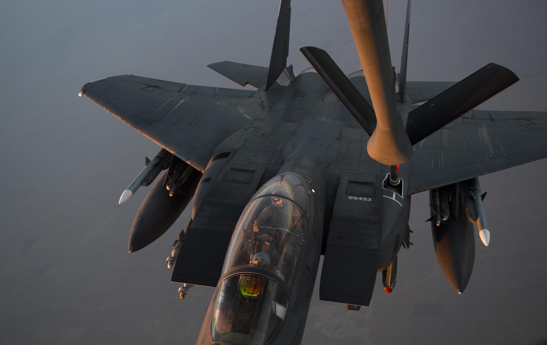An F-15 Eagle receives fuel from a KC-135 Stratotanker  over Iraq in support of Operation Inherent Resolve July 8, 2016. The KC-135 provides the core aerial refueling capability for the U.S. Air Force and has excelled in this role for more than 50 years. (U.S. Air Force photo by Staff Sgt. Douglas Ellis/Released)
