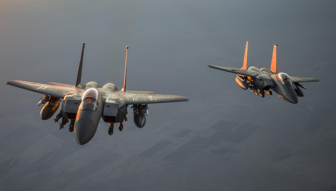 Two F-15 Eagles fly together after receiving fuel from a KC-135 Stratotanker  over Iraq in support of Operation Inherent Resolve July 8, 2016. The KC-135 provides the core aerial refueling capability for the U.S. Air Force and has excelled in this role for more than 50 years. (U.S. Air Force photo by Staff Sgt. Douglas Ellis/Released)