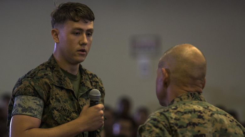 """Pfc. Lucas Smith asks Gen. Robert B. Neller a question during his visit to Camp Kinser, Okinawa, Japan, October 13, 2016. Neller is visiting III Marine Expeditionary Force to reinforce the importance of every Marine and Sailor and their role in continuing the mission of the 'Fight Tonight' MEF. Whether responding to a crisis or natural disaster, III MEF continues to train to ensure its capabilities in keeping peace and security throughout the region. """"I'm not looking to pick a fight with anybody, but you need to be ready to go,"""" said Neller. Neller, from East Lansing, Michigan, is the commandant of Marine Corps. Smith, from Cleveland, Ohio is a warehouse clerk at 3rd Supply Battalion, 3rd Supply Company, III Marine Logistics Group, III MEF."""