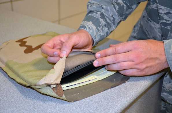 A new type of flexible body armor developed through a collaboration between the Air Force and Naval Research Laboratories is 50 percent lighter than current body armor. The design makes the use of a ceramic ball matrix encapsulated in foam material, which is then backed with multiple layers of polyethylene sheets. (U.S. Air Force photo by Marisa Novobilski/released)