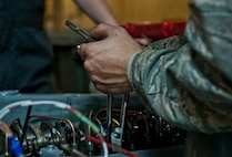 An aerospace ground equipment Airman with the 5th Maintenance Squadron performs a tune-up on an engine at Minot Air Force Base, N.D., Oct. 5, 2016. The AGE specialists ensure Minot AFB's B-52H Stratofortress equipment is serviceable and ready for flight. (U.S. Air Force photo/Airman 1st Class Jonathan McElderry)
