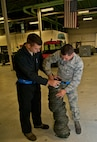 (From left) Airman 1st Class Michael Billen, 5th Maintenance Squadron aerospace ground equipment apprentice, and Airman 1st Class Thomas Erickson, 5 MXS AGE diesel mechanic, connect two air ducts at Minot Air Force Base, N.D., Oct. 5, 2016. Air ducts connect to an MA-3D air conditioner which are used to transfer cold air to aircraft. (U.S. Air Force photo/Airman 1st Class Jonathan McElderry)