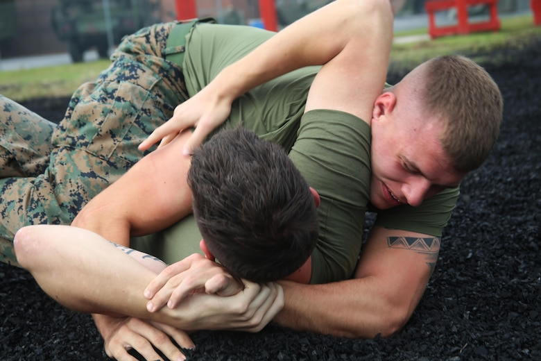Lance Cpl. David Sigdestad spars with Sgt. James Metzgar during a Marine Corps Martial Arts training session aboard Marine Corps Air Station Cherry Point, N.C., Oct. 4, 2016. Despite only being at his current unit for six short months, Sigdestad makes the most out of every moment no matter if he is working hard in a field operation or sparring in MCMAP. Sigdestad and Metzgar are data systems specialists with Marine Wing Communications Squadron 28, 2nd Marine Aircraft Wing. (U.S. Marine Corps photo by Lance Cpl. Mackenzie Gibson/Released)