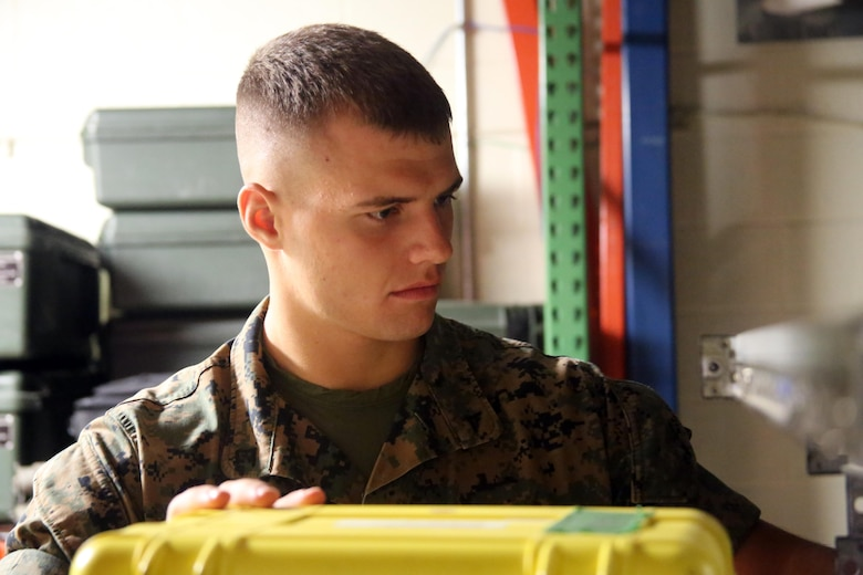 Lance Cpl. David Sigdestad moves data systems equipment in a warehouse aboard Marine Corps Air Station Cherry Point, N.C., Oct. 4, 2016. Despite only being at his current unit for six short months, Sigdestad makes the most out of every moment no matter if he is working hard in a field operation or sparring in a martial arts session. Sigdestad is a data systems specialist with Marine Wing Communications Squadron 28, 2nd Marine Aircraft Wing. (U.S. Marine Corps photo by Lance Cpl. Mackenzie Gibson/Released)