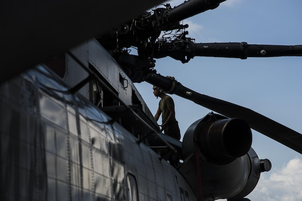 U.S. Marines assigned to the Special Purpose Marine Air-Ground Task Force - Southern Command perform maintenance on a CH-53E super stallion helicopter after a disaster relief mission at Port-au-Prince, Haiti, Oct. 12, 2016. The unit is launching multiple missions each day, delivering supplies to areas affected by Hurricane Matthew. (U.S. Air Force Photo by Tech. Sgt. Russ Scalf)