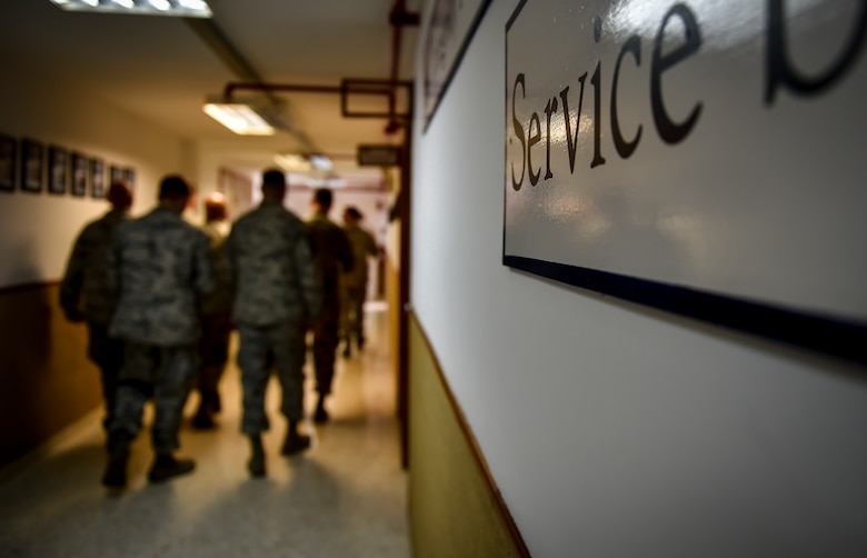 "A plaque, with ""Service before self,"" painted on, is displayed on a wall at Morón Air Base, Spain, Oct. 4, 2016. With a unit of only 600 personnel, Airmen at Morón make up only 25 percent of that population. Team Morón is comprised of U.S. Airmen, Marines and Spanish air force members, who operate together to keep wheels off the ground and in the fight. The 496th Air Base Squadron, a geographically-separated unit from the 86th Airlift Wing, Ramstein Air Base, Germany, provides a worldwide platform for air power. (U.S. Air Force photo by Senior Airman Nicole Keim)"