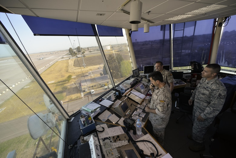 U.S. Air Force and Spanish air force air traffic controllers, watch the flightline at Morón Air Base, Spain, Oct. 4, 2016. With a unit of only 600 personnel, Airmen at Morón make up only 25 percent of that population. Team Morón is comprised of U.S. Airmen, Marines and Spanish air force members, who operate together to keep wheels off the ground and in the fight. The 496th Air Base Squadron, a geographically-separated unit from the 86th Airlift Wing, Ramstein Air Base, Germany, provides a worldwide platform for air power. (U.S. Air Force photo by Senior Airman Nicole Keim)