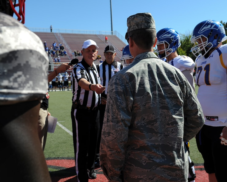 Hundreds of military families attended a free tailgate and game during Military Appreciation Day at the University of Central Missouri (UCM) in Warrensburg, Mo., Oct. 8, 2015. U.S. Air Force Brig. Gen. Paul W. Tibbets IV, thw 509th Bomb Wing commander, performed a coin toss before the start of the game.