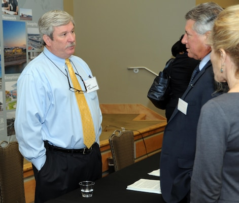 Garry Runyans, Huntsville Ceter Automated Systems Branch chief, speaks with small business representatives during the Hun tsville Center's 17th Annual Small Business Forum Oct. 12 at the Jackson Center at Cummings Research Park.The event provides an opportunity for small business representatives to discuss their capabilities with Huntsville Center contracting officials and program managers to learn about upcoming Huntsville Center acquisitions.