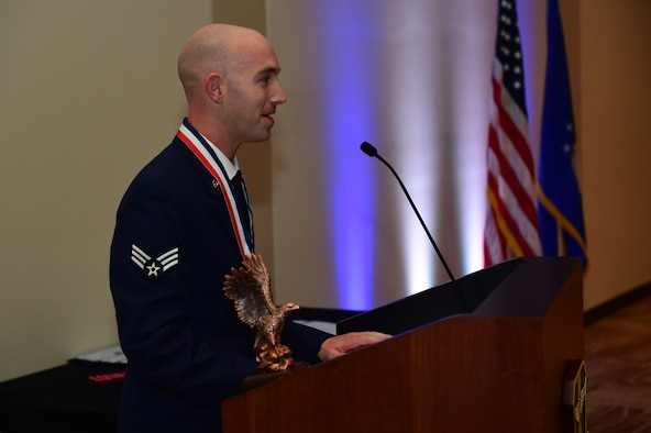 Senior Airman Alexander Nelson, John L. Levitow recipient, speaks during an Airman Leadership School graduation Oct. 13, 2016, at the Leadership Development Center on Buckley Air Force Base, Colo. John L. Levitow is the lowest ranking Airman to earn the Medal of Honor in 1969 during the Vietnam War. Nelson is assigned to the Aerospace Data Facility Detachment 6 as an operations integrator. (U.S. Air Force photo by Airman 1st Class Gabrielle Spradling/Released)