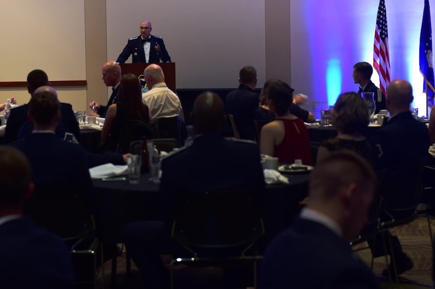 Col. David Miller Jr., 460th Space Wing commander, speaks during an Airman Leadership School graduation Oct. 13, 2016, at the Leadership Development Center on Buckley Air Force Base, Colo. This graduation represents an important part of enlisted force professional military education, teaching valuable skills required for supervisors. (U.S. Air Force photo by Airman 1st Class Gabrielle Spradling/Released)