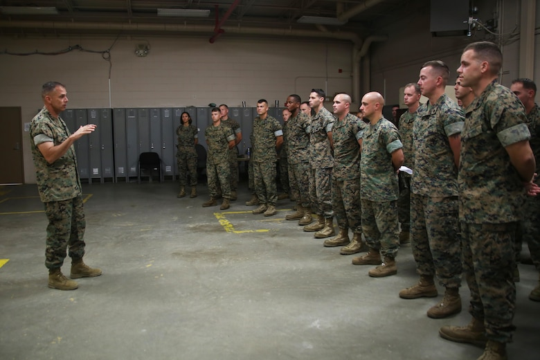 """Brig. Gen. Matthew Glavy visits Marines with Marine Wing Support Detachment 31 aboard Marine Corps Air Station Beaufort, S.C., Oct. 14, 2016. Glavy visited the air station to assess the effects of Hurricane Matthew and attend the Marine Fighter Attack Squadron 122 change of command ceremony. Glavy issued the Navy and Marine Corps Achievement Medal to Capt. Seve Aguinaga and commended all the Marines there for their tremendous efforts in preparing and responding to the storm, noting they """"were fighting outside of their weight class"""" after conducting operations normally expected of larger support squadrons to minimize impacts of the hurricane. (U.S. Marine Corps photos by Lance Cpl. Mackenzie Gibson/Released)"""