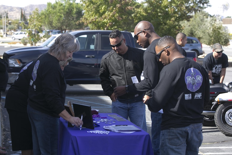 Combat Center Marines talk with members of the Unity Home in Yucca Valley, Calif., during the 3rd Annual Domestic Violence Awareness Poker Run Motorcycle Ride as part of Domestic Violence Awareness Month, Oct. 7, 2016. (Official Marine Corps photo by Cpl. Thomas Mudd/Released)