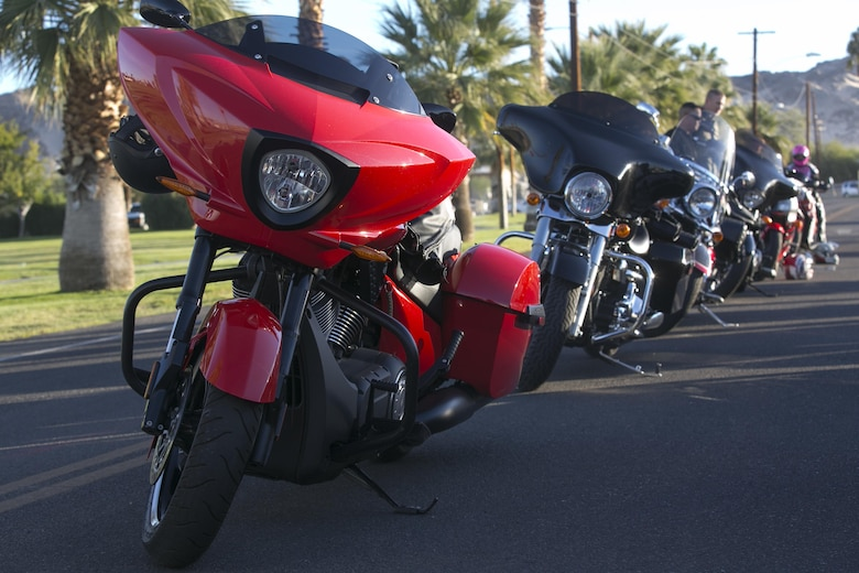 Combat Center Motorcycle riders line up their vehicles before the start of the 3rd Annual Domestic Violence Awareness Poker Run Motorcycle Ride at the Protestant Chapel aboard the Marine Corps Air Ground Combat Center, Twentynine Palms, Calif., Oct. 7, 2016. (Official Marine Corps photo by Cpl. Thomas Mudd/Released)