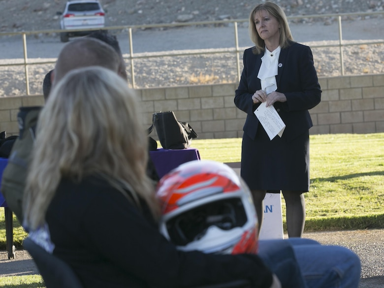 Michelle Bergey, deputy district attorney, San Bernardino County, talks about domestic violence to the participants of the 3rd Annual Domestic Violence Awareness Poker Run Motorcycle Ride at the Protestant Chapel aboard Marine Corps Air Ground Combat Center, Twentynine Palms, Calif., Oct. 7, 2016. (Official Marine Corps photo by Cpl. Thomas Mudd/Released)