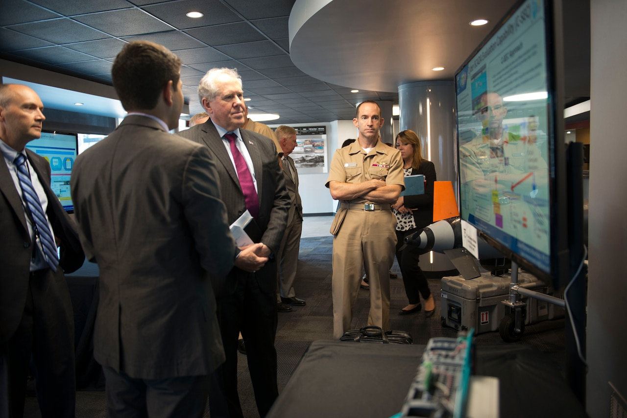 Frank Kendall, undersecretary of defense for acquisition, technology and logistics, announced Oct. 12, 2016, the continuation of an over-cost program supporting the global positioning system. Here, Kendall is briefed by Jose Romero-Mariona on cybersecurity science and technology during Kendall's visit to Space and Naval Warfare Systems Center Pacific in San Diego. Aug. 24, 2016. Navy photo by Aaron Lebsack