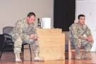 Staff Sgt. Christopher J. Estrada (left), a fire support sergeant, and Staff Sgt. Thomas Drummer, an intelligence analyst, both assigned to Headquarters and Headquarters Battery, 1st Infantry Division Artillery, perform suicide prevention skits Sept. 27 at Barlow Theatre on Fort Riley. The skits were performed as part of National Suicide Prevention Awareness Month to educate Soldiers on what to detect when someone is contemplating suicide.