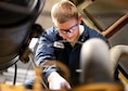 Senior Airman Robert Bales, 319th Logistics Readiness Squadron vehicle maintenance journeyman, performs routine maintenance on an Oshkosh 26' Snow Plow Oct. 13, 2016, on Grand Forks Air Force Base, N.D. The 319th LRS spends months preparing vehicles for the harsh winter conditions in North Dakota. (U.S. Air Force photo by Senior Airman Ryan Sparks/Released)