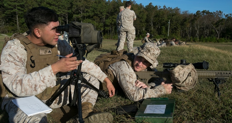 Cpl. Issac Camberos (left) assesses Lance Cpl. Joseph Lambert's shot group after firing the M110 Semi-Automatic Sniper System during designated marksman sustainment training aboard Naval Air Station Oceana Dam Neck, Va., Oct. 12, 2016.  The six designated marksmen from 6th platoon, Company A, Fleet Anti-Terrorism Security Team, Marine Corps Security Force Regiment, practiced other techniques which included firing from different distances, different positions and engaging multiple targets. (Official U.S. Marine Corps photo by Sgt. Calvin Shamoon/ Released)