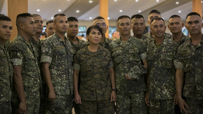 U.S. and Philippine Marines pose for a photo at the end of the Philippine Amphibious Landing Exercise 33 closing ceremony at Marine Barracks Rudiardo Brown, Taguig City, Philippines, Oct. 11, 2016. PHIBLEX is an annual U.S.-Philippine military bilateral exercise that combines amphibious capabilities and live-fire training with humanitarian civic assistance efforts to strengthen interoperability and working relationships.