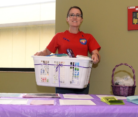 Allysyn Lasch, 9th Medical Operations Squadron family advocacy outreach manager picks up donations made by Beale Airmen Oct. 14, 2016, at Beale Air Force Base, California. Squadrons and Units across base are collecting donations for five local domestic violence shelters Beale is helping. (U.S. Air Force photo/Airman Tristan D. Viglianco)