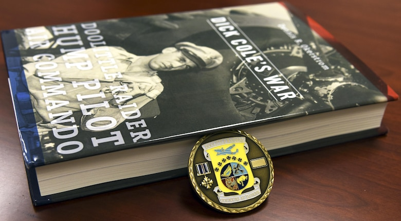Retired Lt. Col. Richard Cole, the last remaining Doolittle Raider, gave the 337th Test and Evaluation Squadron a Doolittle Raider coin and book as a token of appreciation for naming the Air Force's newest bomber in their honor. Cole was invited to the naming ceremony last month when the Air Force introduced the bomber as the B-21 Raider. (Courtesy photo)