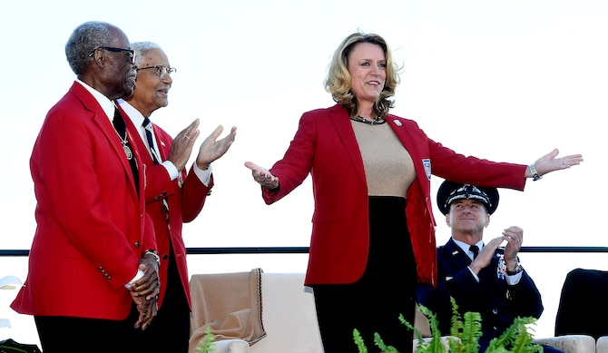 Secretary of the Air Force Deborah Lee James receives her honorary Tuskegee Airman red jacket during the Air Force Memorial's 10th anniversary ceremony in Arlington, Va., Oct. 14, 2016.  (U.S. Air Force photo/Scott M. Ash)
