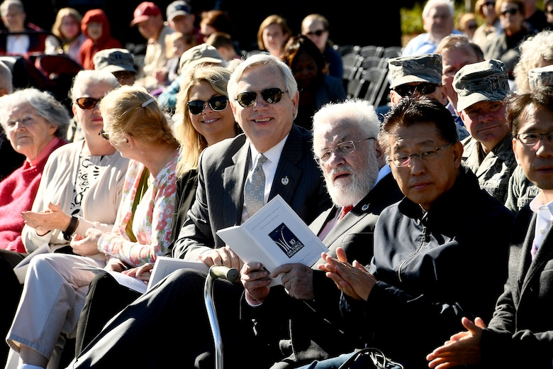 Adrian Cronauer, a Vietnam-era Air Force disc jockey, references the event program during the Air Force Memorial's 10th anniversary ceremony in Arlington, Va., Oct. 14, 2016. (U.S. Air Force photo/Scott M. Ash)