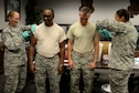 U.S. Air Force Chief Master Sgt. Christopher McKinney, 20th Fighter Wing command chief, center left, and Col. Daniel Lasica, 20th FW commander, center right, receive their mandatory annual flu shots at Shaw Air Force Base, S.C., Oct. 13, 2016. Each year, the 20th Medical Group offers free flu shots for all of Shaw's service members and Defense Department civilians. (U.S. Air Force photo by Airman BrieAnna Stillman)