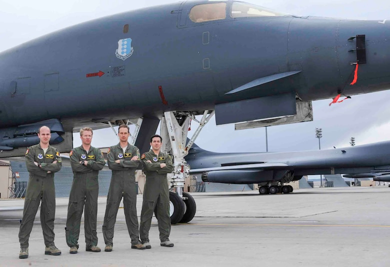 The 2015 General Curtis E. LeMay award winning aircrew from the 37th Bomb Squadron stand next to a B-1 Lancer at Ellsworth Air Force Base, S.D., March 7, 2016. Their success in a bombing mission during Operation Iron Resolve destroyed oil fields supplying income to Islamic State of Iraq and the Levant and won the award for the best bomber crew of 2015. (U.S. Air Force photo by Airman 1st Class Denise M. Jenson)