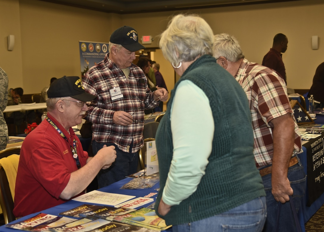 Retirees speak with a representative from Fleet Reserve Association during the Retiree Appreciation Day event Oct. 14, 2016, at the Red Morgan Center at Fairchild Air Force Base, Wash. The event included multiple booths from different agencies to explain their services, including: Veterans Affairs, base legal, American Legion and Tricare. During the event four informational presentations about Tricare, ID cards, legal assistance and casualty assistance were given. (U.S. Air Force photo/Airman 1st Class Taylor Shelton)