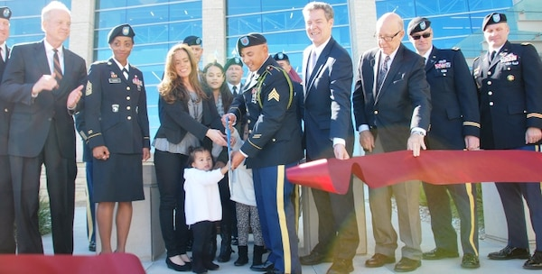 Officials cut the ribbon at the new Irwin Army Community Hospital, Fort Riley, Oct. 12, 2016. 