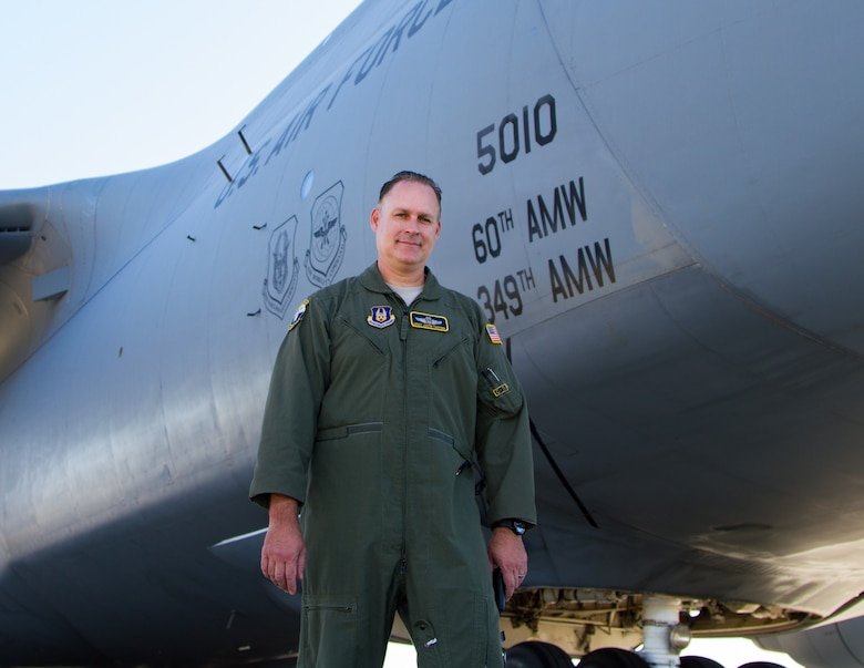 Chief Master Sgt. Justin Toomsen, 312th Airlift Squadron, poses for a photo outside a C-5M Super Galaxy at Travis Air Force Base, Calif. Toomsen challenges all Airmen to strive for excellence in all they do and maintain positive attitudes. (U.S. Air Force courtesy photo)