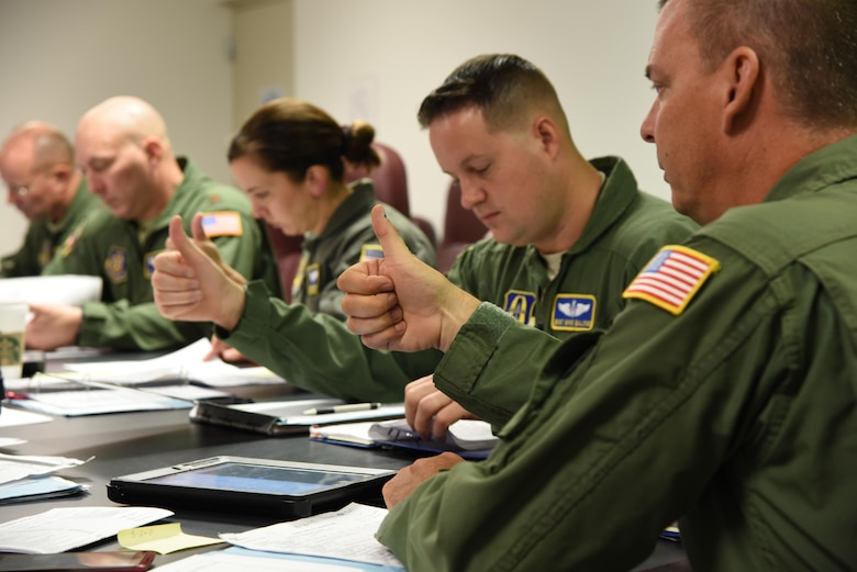 Members of the 36th Aeromedical Evacuation Squadron give the thumbs up to show their understanding of safety guidelines during a mission briefing Oct. 14. The mission was their first out of Keesler Air Force Base, Miss. in coordination with the 53rd Weather Reconnaissance Squadron. (U.S. Air Force photo/Maj. Marnee A.C. Losurdo)