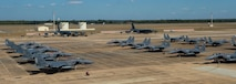 B-52 Stratofortresses share the flightline with F-15E Strike Eagles share the flightline at Barksdale Air Force Base, La., Oct. 7, 2016. More than 100 aircraft relocated from East Coast bases in order to avoid potential damage associated with Hurricane Matthew. (U.S. Air Force photo/Senior Airman Curt Beach)