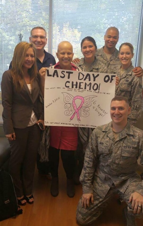 Tech. Sgt. Moira Howerton, 113th Communications Flight, D.C. Air National Guard, poses with co-workers on her last day of chemotherapy to treat stage 2, triple negative breast cancer. Howerton underwent 16 rounds of aggressive chemotherapy. (Photo courtesy of Tech. Sgt. Howerton)