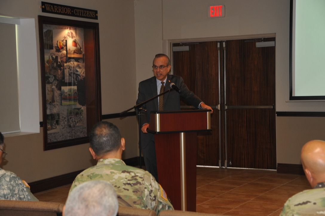 Brig. Gen. (Retired) Fernando Fernandez addresses Soldiers, civilians and Family members of the 1st Mission Support Command during a Hispanic Heritage event held at Ramos Hall on Fort Buchanan, October 15.