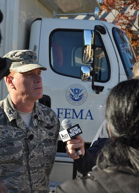 Col. Jim Kellogg, 94th Airlift Wing vice commander, speaks to several media outlets at a FEMA command post location on Dobbins Air Reserve Base, Georgia Oct. 12, 2016. Dobbins served as a staging location for the FEMA Urban Search and Rescue Blue Incident Support Team while they provided rapid federal response to local, federal, state and tribal agencies in support of Hurricane Matthew. (U.S. Air Force photo/James Branch)