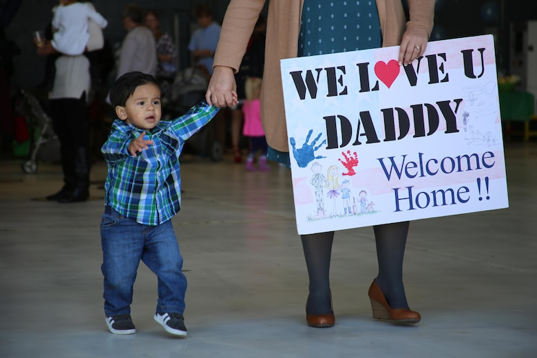 A child eagerly waits for his father during a deployment homecoming aboard Marine Corps Air Station Cherry Point, N.C., Oct. 10, 2016. More than 20 air crew members with Marine Tactical Electronic Warfare Squadron 4 returned after a six-month deployment with the United States Central Command aboard Incirlik Air Base in Turkey. According to Lt. Col. Paul K. Johnson III, commanding officer for VMAQ-4, the Marines conducted electronic warfare and disrupted ISIS communications in Iraq and Syria in support of Operation Inherent Resolve. This deployment was the last that VMAQ-4 will participate in because the squadron is scheduled to be deactivated in the summer of 2017. (U.S. Marine Corps photo by Lance Cpl. Mackenzie Gibson/Released)
